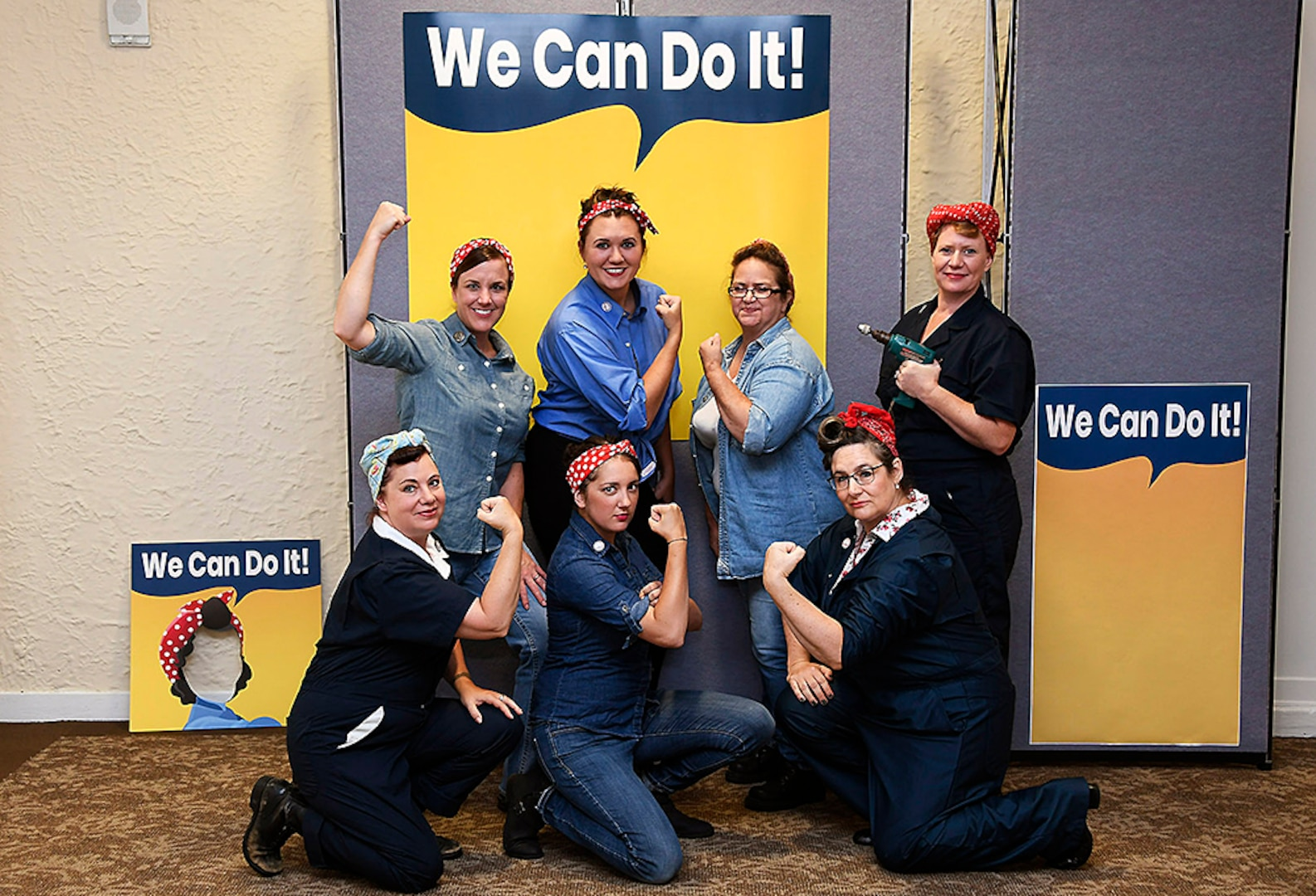 The stories of WWII-era working women were recently produced and portrayed in commemoration of Women's Equality Day by DLA's Renelle Hansen, Elli Blonde, Angel Morgan, Robin Rogers (top row), Tina Lilly, Stacy Marsala, Zoe Orchel (bottom row) and others in Battle Creek, Michigan.