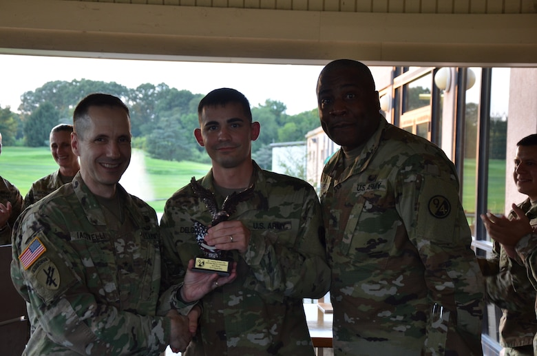 Sgt. Antonio Delgado, 5/80th Ordnance Battalion, 2nd Brigade (Ordnance), 94th Training Division – Force Sustainment, earns the Best Warrior trophy at the conclusion of the 94th's 2019 Best Warrior Competition at Joint Base McGuire–Dix–Lakehurst, New Jersey. Army Reserve competitors' mental and physical toughness was put to the test as they endured early morning and late-night events where only one competitor would claim the title for this competition.