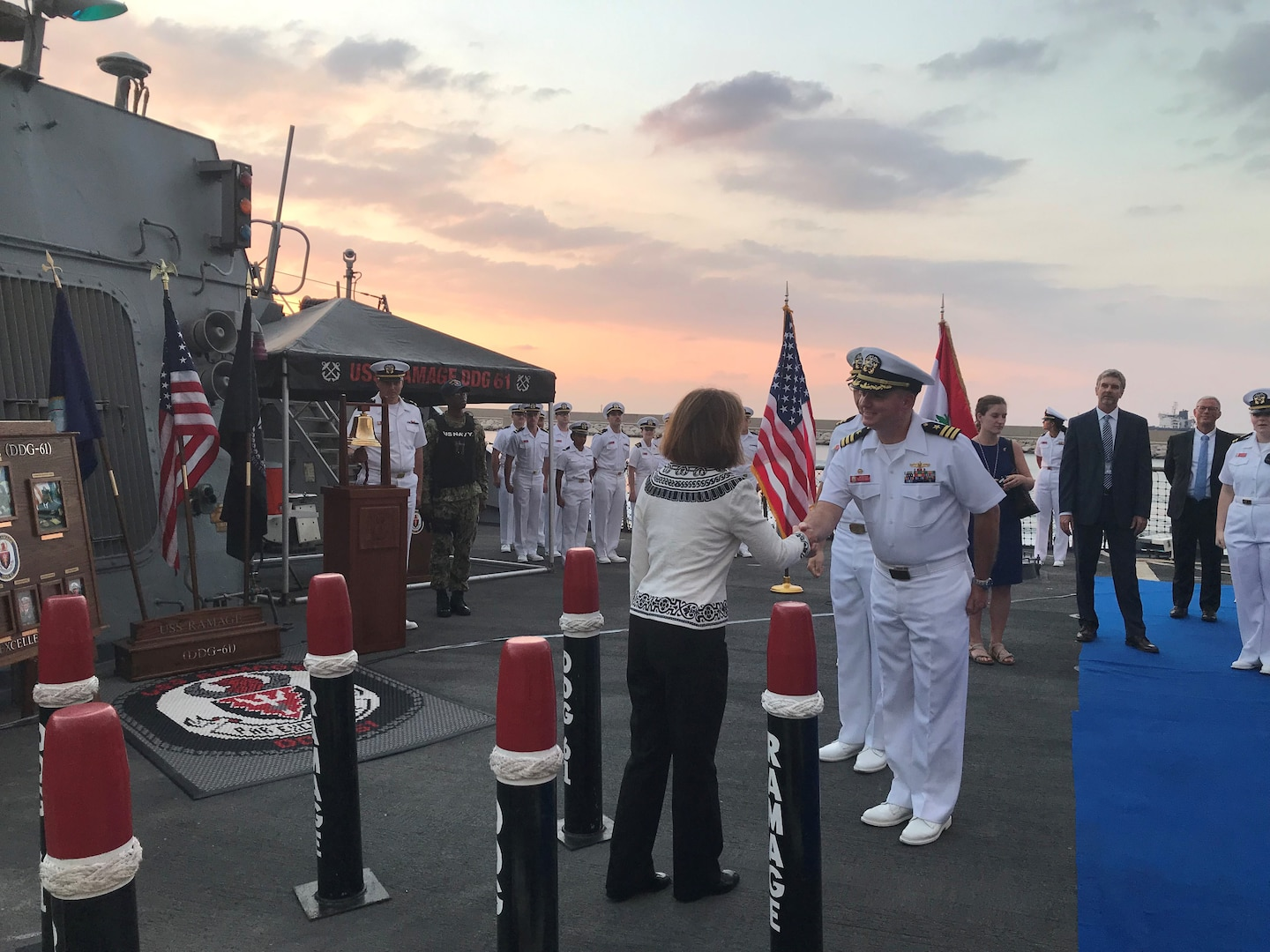 190915-N-N0146-001 BEIRUT, Lebanon (Sept. 15, 2019) Cmdr. John B. Benfield, commanding officer of the guided-missile destroyer USS Ramage (DDG 61), greets U.S. Ambassador to Lebanon, Elizabeth Richard, during a reception. Ramage made an historic port visit to Beirut on Sept. 14, the first time in 36 years a U.S. warship had pulled into the country. (U.S. Navy photo/Released)