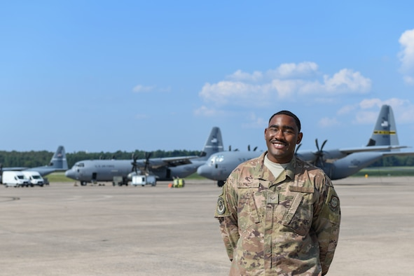 a man stands on the flight line