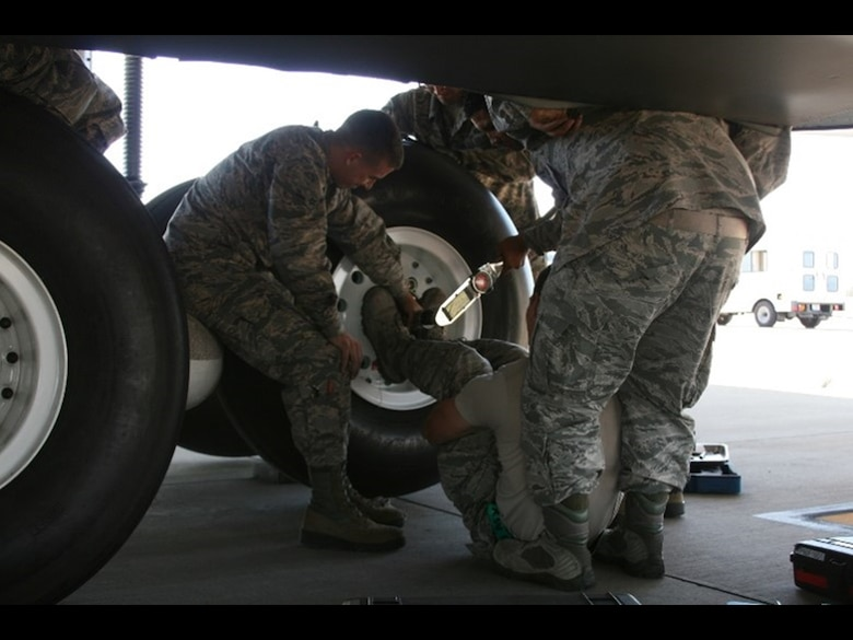 Current C-5 cargo airplane tire replacement requires up to five Airmen with a multitude of tools to replace a tire. The Air Force Research Laboratory Junior Force Warfighter Operations Team works on a solution for this awkward and uncomfortable task.(U.S. Air Force photo)