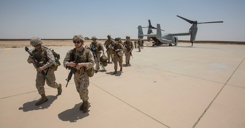 After a cyberattack, the waiting is the hardest part: U.S. Marines debark from an MV-22B Osprey at Al Asad Air Base, Iraq in June 2018. A cyberattack could slow how U.S. forces respond to a battlefield.