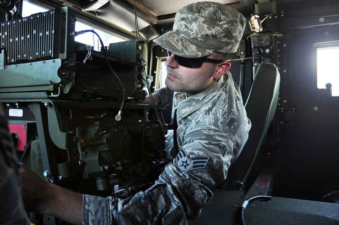 Senior Airman Christopher Hudson, 445th Civil Engineer Squadron HVAC and refrigeration Journeyman, prepares a Humvee for tactical convoy training Aug. 3, 2019.