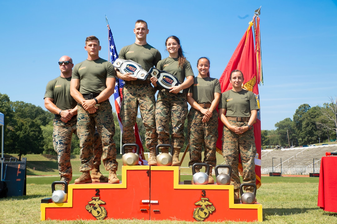 (From left to right) U.S. Marines 1st Lt. Tyler Watkins, Sgt. Anthony Gates, Sgt. Kevin Fisch, Cpl. Alexandra Martin, Capt. Stefanie Allen, and 1st Lt. France Moore won the first, second and third place of the 2019 High Intensity Tactical Training Championship aboard Marine Corps Base Quantico, Sept. 12, 2019. Martin came in first place, as well as Fisch, who won for the second year in a row. Competitors from all across the Marine Corps battle for the title of HITT Champion. The championship spans over four days, and includes seven challenges, which test the athletes' physical and mental fortitude.