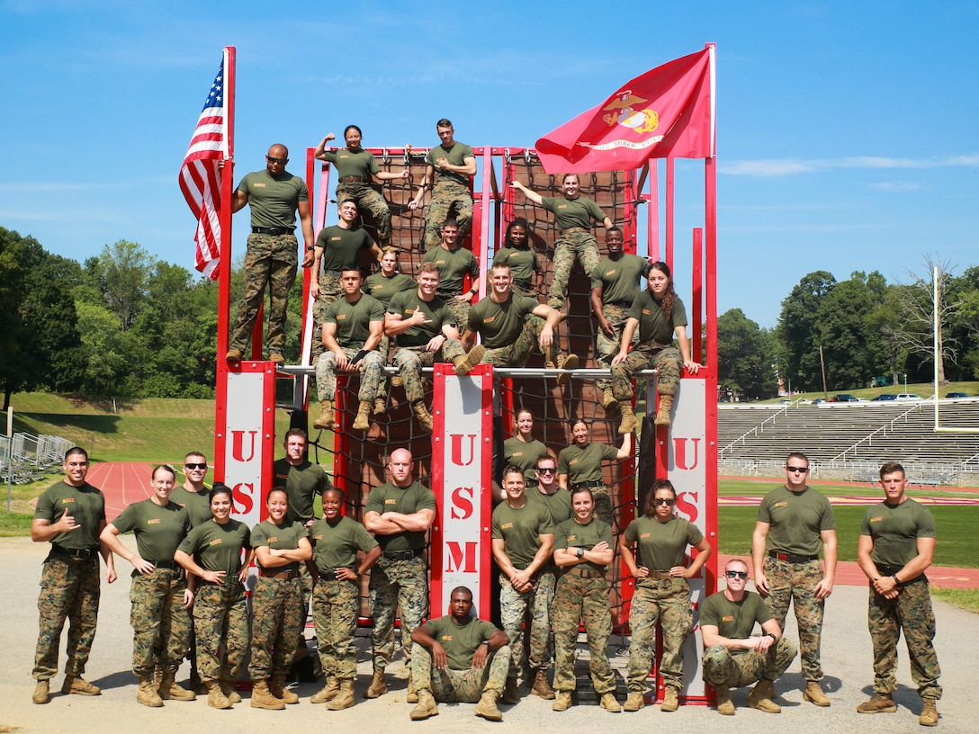 Participants of the 2019 High Intensity Tactical Training Championship celebrate completing the competition, which spans over four days, and includes seven challenges testing the athletes' physical and mental fortitude, aboard Marine Corps Base Quantico on Sept. 12, 2019. Competitors from all across the Marine Corps battle for the title of HITT Champion.