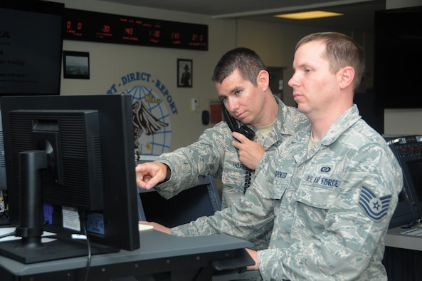 Senior Master Sgt. Darrell Hornback, 445th Command Post superintendent, conducts training with Tech. Sgt. Patrick Carpenter.