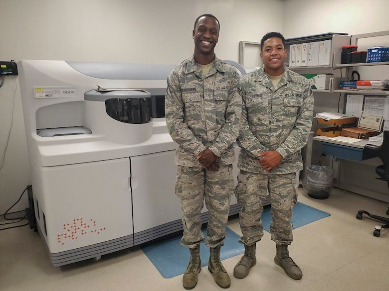 Senior Airmen Jean M. Desrosiers and Angel J. Latorre, both laboratory technicians with the 514th Aerospace Medicine Squadron, 514th Air Mobility Wing at Joint Base McGuire-Dix-Lakehurst, N.J., pose for a photo September 15, 2019. Both Desrosiers and Latorre began their U.S. Air Force careers in November 2012 and have worked together since.