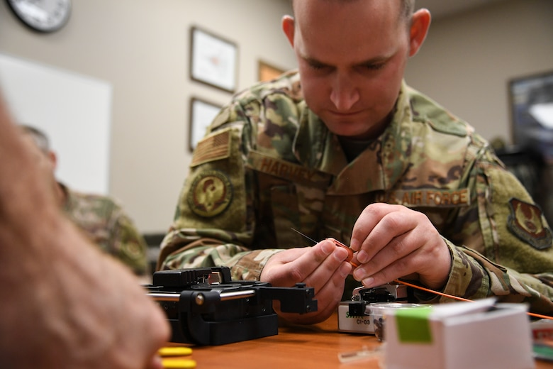 Tech. Sgt Kenan Harvey, 309th Expeditionary Depot Maintenance avionics technician, splices a fiber optic cable during a fusion splice field test at Hill Air Force Base, Utah, Sept. 10, 2019.