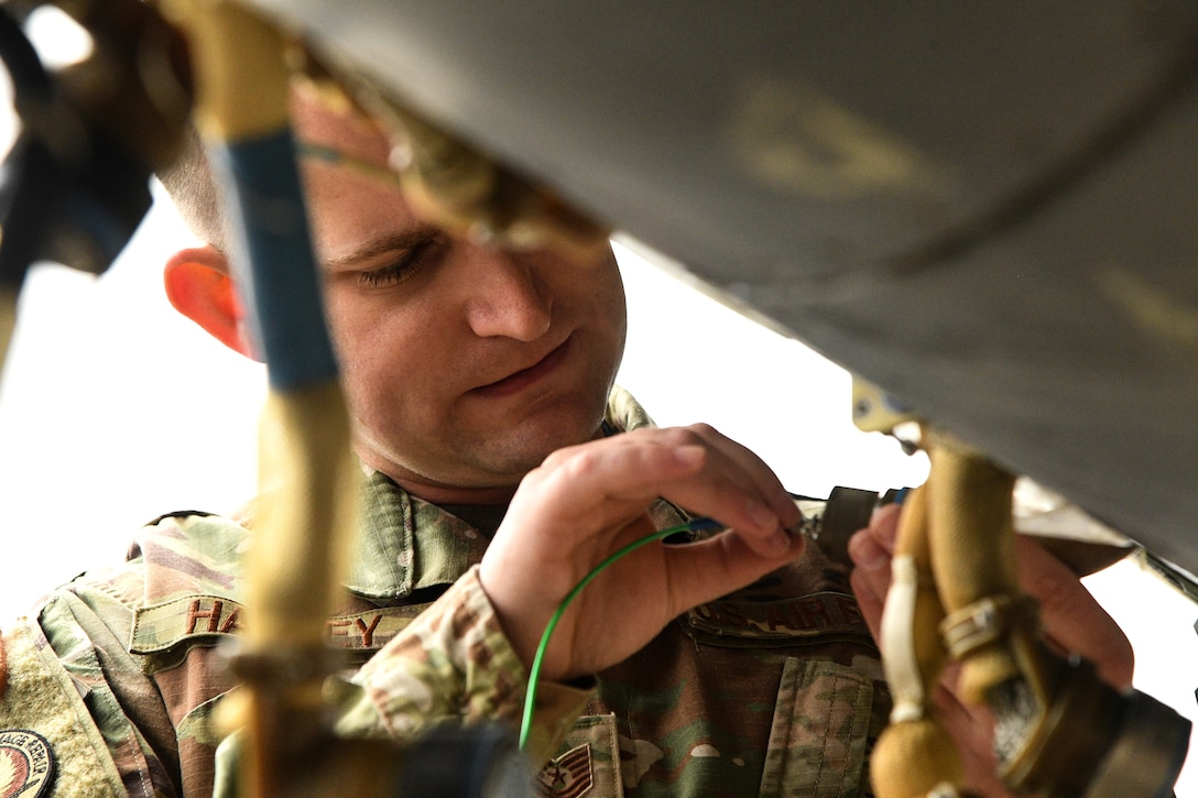 Tech. Sgt Kenan Harvey, 309th Expeditionary Depot Maintenance avionics technician, tests a fiber optic cable for signal loss at Hill Air Force Base, Utah, Sept. 11, 2019.