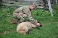 U.S. Army Reserve Spec. Erik Letson, a Civil Affairs Soldier with B Company, 401st Civil Affairs Battalion, practices the proper technique for holding a sheep so that it can be assessed for disease or injury.
