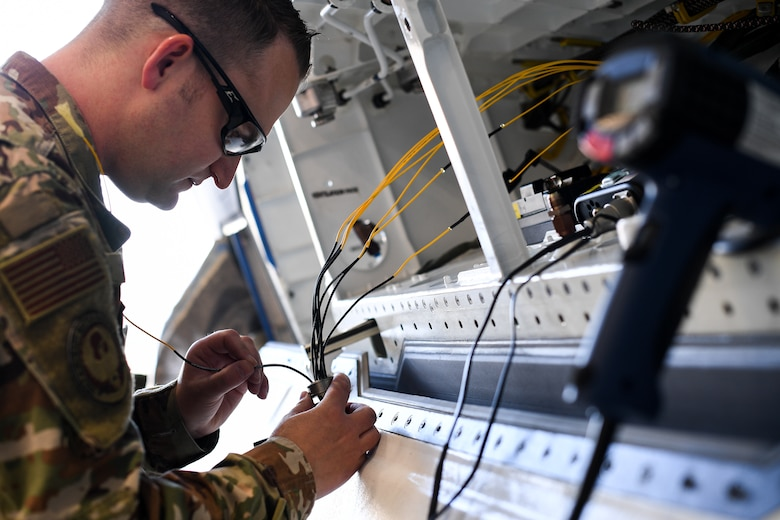 Tech. Sgt. Harvey, 309th Expeditionary Depot Maintenance avionics technician, performs a fiber optic fusion splice repair on an F-35A Lightning II at Hill Air Force Base, Utah, Sept. 12, 2019.
