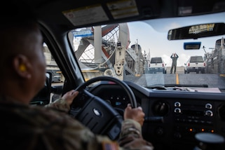 U.S. Army Lt. Col. Mario Oliva, assigned to Joint Task Force Civil Support (JTF-CS) follows directions from U.S. Navy Aviation Boatswain's Mate (Handling) 2nd Class Shanks Bradley, assigned to Assault Craft Unit FOUR (ACU 4), while loading a vehicle onto a landing craft air cushion (LCAC) during a mobile exercise. The purpose of the exercise was to increase the command's capability to operate with the Navy to safely and efficiently deploy its vehicles and personnel during a catastrophic event. When directed, JTF-CS is ready to respond in 24 hours to provide command and control of 5,200 federal military forces located at more than 36 locations throughout the nation acting in support of civil authority response operations to save lives, prevent further injury, and provide critical support to enable community recover.  (U.S. Navy photo by Chief Mass Communication Specialist Barry Riley/RELEASED)