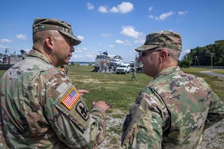 "U.S. Army Col. Eric Oh, left, briefs Joint Task Force Civil Support Commanding General Maj. Gen. William ""Bill"" Hall following a joint mobile exercise with Assault Craft Unit FOUR. The purpose of the exercise was to increase the command's capability to operate with the Navy to safely and efficiently deploy it's vehicles and personnel during a catastrophic event. When directed, JTF-CS is ready to respond in 24 hours to provide command and control of 5,200 federal military forces located at more than 36 locations throughout the nation acting in support of civil authority response operations to save lives, prevent further injury, and provide critical support to enable community recover.  (U.S. Navy photo by Chief Mass Communication Specialist Barry Riley/RELEASED)"