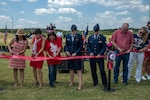 Capt. Mark T. Voss family members participate in the ribbon cutting during the Capt. Mark T. Voss Middle School dedication held in Boerne, Texas, Sept. 14, 2019. The new middle school was named in memory of Voss, who was a 2004 Boerne High School graduate. He graduated from the United States Air Force Academy in 2008 and received his wings in 2010. While in command of an Air Force KC-135 Stratotanker on a combat mission to refuel other planes over Afghanistan, a mishap brought down the plane. Voss and his two crewmates all perished in the accident May 3, 2013.