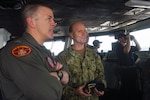 Vice Adm. William R. Merz, Commander, 7th Fleet, speaks with Capt. Pat Hannifin, the commanding officer of the Navy's forward-deployed aircraft carrier USS Ronald Reagan (CVN 76), while touring the Reagan. USS Ronald Reagan, the flagship of Carrier Strike Group 5, provides a combat-ready force that protects and defends the collective maritime interests of its allies and partners in the Indo-Asia-Pacific region.