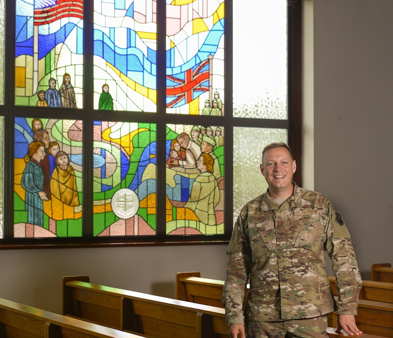 Captain Graham Baily, Chaplain assigned to the 509th Bomb Wing, stands in the chapel at Royal Air Force Fairford, England. Baily was deployed with members of the 509th Bomb Wing for the Bomber Task Force mission. His role in the mission is to provide for and accommodate Airmen's First Amendment right to freely exercise their religion. Baily also provides pastoral care which includes privileged counseling, worship services, and morale trips for the Airmen on this deployment.