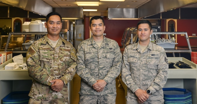 Technical Sergeant Flint Almiron, Staff Sergeant Jose Rangel, and Airman 1st Class Daniel Duenas, services Airmen assigned to the 509th Force Support Squadron, work in the dining facility at Royal Air Force Fairford, England, during the Bomber Task Force mission. These Airmen work as quality assurance and oversee the contract dining facility workers to ensure quantity and quality of the food served to Airmen during the Bomber Task Force Deployment.