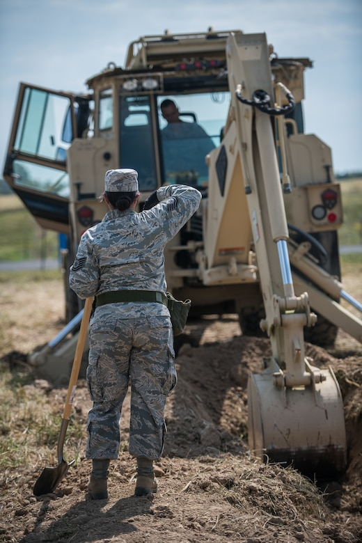 U.S. Air Force Reserve Citizen Airman Tech. Sgt. Tiana Corpuz gives Tech. Sgt. Casey Goodaker, both 932nd Civil Engineer Squadron technicians, instructions on where to dig during field training, Sept. 10, 2019 at the Sparta National Guard training area, Sparta, Illinois. (U.S. Air Force photo by Master Sgt. Christopher Parr)