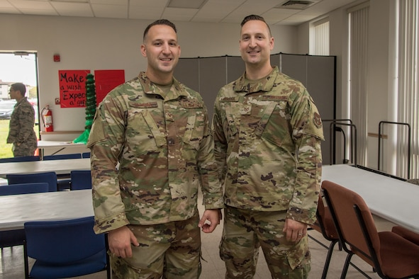 """Tech. Sgt. David Misiura Jr., and his brother Staff Sgt. Josiah D. Misiura, both air transportation specialists in the 88th Aerial Port Squadron, 514th Air Mobility Wing at Joint Base McGuire-Dix-Lakehurst, N.J., pose for a photo September 14, 2019. The brothers are among many """"Port Dawgs"""" from the 88th APS who are gearing up to deploy."""