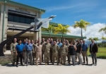Participants of the Integrated Air and Missile Defense Center summit pose in front of the Hawaii Air National Guard Headquarters building, Joint Base Pearl Harbor-Hickam, Hawaii, Sept. 10, 2019. The purpose of the event – in its fifth iteration – is to provide a forum to exchange information, share lessons learned and best practices across the three Integrated Air and Missile Defense Centers. During the three-day conference, 30 participants received briefings on regional and global threats, emerging U.S. integrated air and missile defense capabilities, and were updated by the different Integrated Air and Missile Defense Centers around the globe.