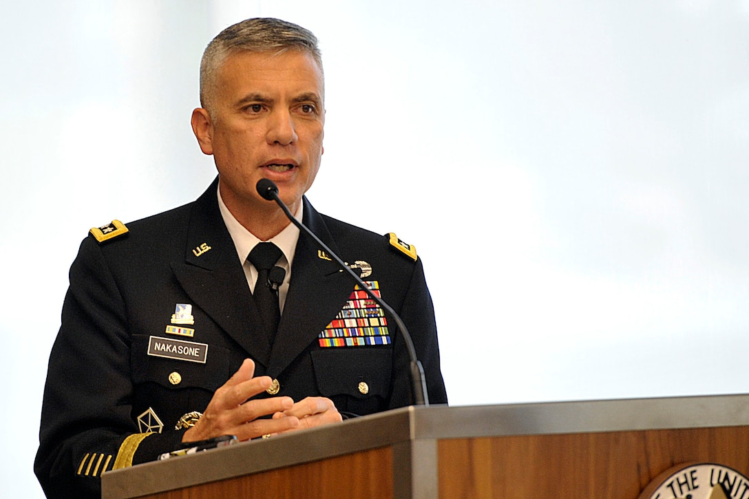 Four-star Army general speaks at lectern.