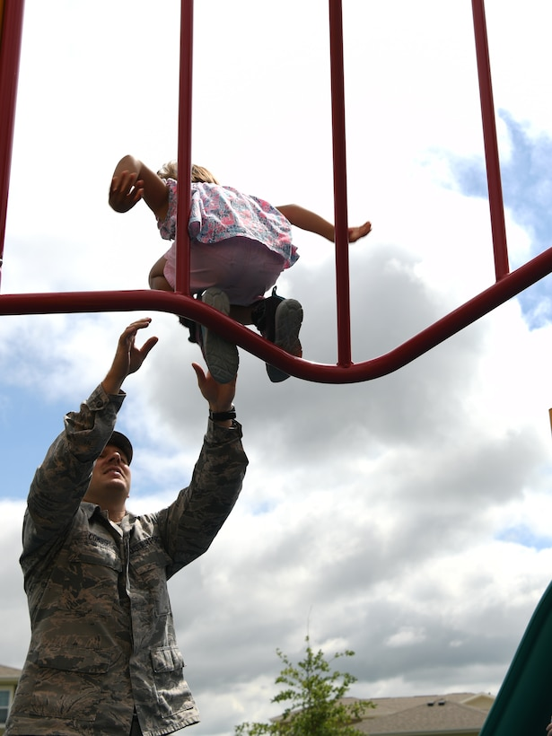 Staff Sgt. Jordan Combs, a 28th Bomb Wing administration executive support specialist, catches a foster child at Ellsworth Air Force Base, S.D., Aug. 2, 2019. The Combs' are currently living in on-base housing and came up with the idea to make a foster ranch where they can accommodate many more children. (U.S. Air Force photo by Senior Airman Thomas Karol)
