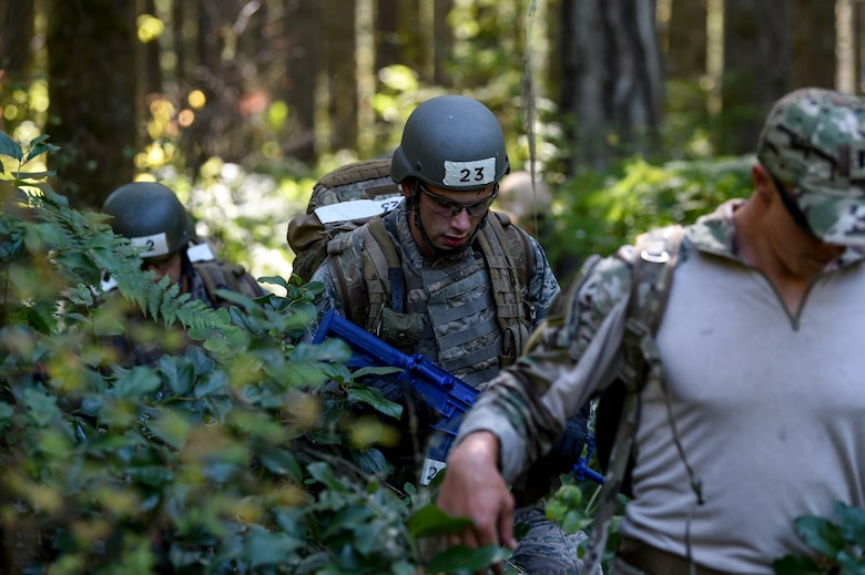 A team of tactical air control party (TACP) officer candidates navigate to a set of given coordinates as part of a land navigation exercise during the TOPT selection course phase II on Joint Base Lewis-McChord, Wash., Aug. 27, 2019. Candidates were required to navigate to five different coordinates where a different team challenge for them to be evaluated on awaited them at each new location.