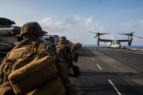 Marines with Echo Company, Battalion Landing Team, 2nd Battalion, 1st Marines, 31st Marine Expeditionary Unit, load onto an MV-22B Osprey tiltrotor aircraft prior to a simulated airfield seizure as part of a long-range raid from the amphibious assault ship USS Wasp (LHD 1), Philippine Sea, Aug. 12, 2019. The 31st MEU and Amphibious Squadron 11, aboard Wasp Amphibious Ready Group ships, conducted a series of sequential operations which simulated naval expeditionary combined-arms maneuver from amphibious assets to shore, utilizing Marine Air-Ground Task Force capabilities integrated across all warfighting domains. (U.S. Marine Corps photo by Lance Cpl. Kenny Nunez Bigay)