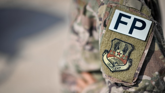A force protection flight special duty patch is photographed at Ali Al Salem Air Base, Kuwait, Sept. 4, 2019. The force protection flight is assigned to the 386th Expeditionary Civil Engineer Squadron and is manned by 132 Airmen from over 91 different AFSCs from around the Air Force. (U.S. Air Force photo by Staff Sgt. Mozer O. Da Cunha)