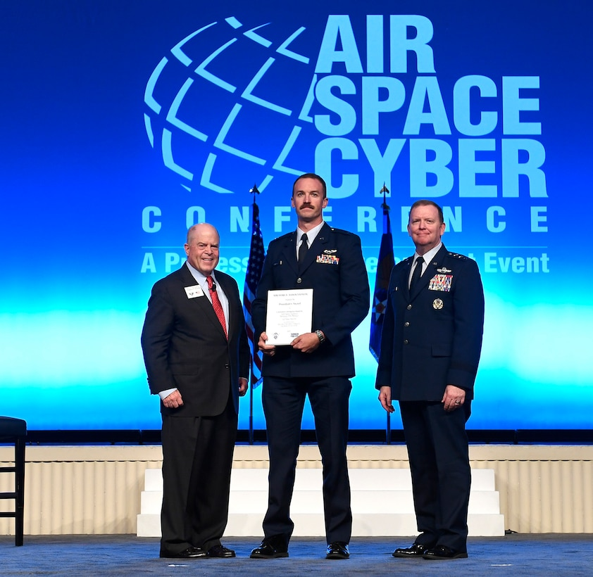 Capt. Charles Phelps receives the President's Award during the Air Force Association Air, Space and Cyber Conference in National Harbor, Maryland, Sept. 16, 2019. The President's Award recognizes outstanding flying achievement. (U.S. Air Force photo by Andy Morataya)