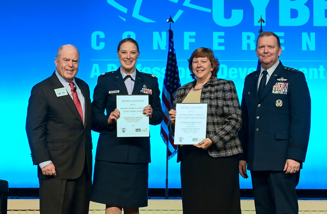 Maj. Sonja Demuth and Karen Anderson receive the Citizen Airman and Employer of the Year Award during the Air Force Association Air, Space and Cyber Conference in National Harbor, Md., Sept. 16, 2019. (U.S. Air Force photo by Andy Morataya)
