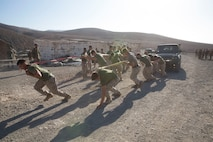 U.S. Marines and Sailors with Special Purpose Marine Air-Ground Task Force-Crisis Response-Africa 19.2, Marine Forces Europe and Africa, pull a vehicle during a field meet in Fuerteventura, Canary Islands, Spain, Sept. 11, 2019. The Marines competed against Spanish soldiers to celebrate the end of their bilateral exercise and increase camaraderie. SPMAGTF-CR-AF is deployed to conduct crisis-response and theater-security operations in Africa and promote regional stability by conducting military-to-military training exercises throughout Europe and Africa. (U.S. Marine Corps photo by Staff Sgt. Mark E Morrow Jr)