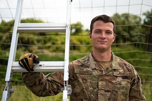 U.S. Air Force Airman 1st Class Jack Murray, 475th Expeditionary Air Base Squadron firefighter, poses for a photo at Camp Simba, Kenya, Aug. 29, 2019. Murray, originally from Tampa Bay, Florida, is responsible for responding to fire emergencies, but also helps train Kenya Navy firefighters on base. During his free time, he lifts weights, participates in Judo, and regularly plays table tennis in the Morale, Welfare, and Recreation center. (U.S. Air Force photo by Staff Sgt. Devin Boyer)