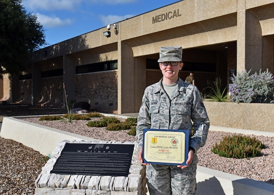 U.S. Air Force Senior Airman Tiffany Jordan, 17th Healthcare Operations Squadron medical technician, stands with the Medic of the Month award outside of the Ross Clinic on Goodfellow Air Force Base, Texas, September 9, 2019. Jordan exceeded her leadership's standards of professionalism and expertise functioning at a flight chief level as a senior Airman. (U.S. Air Force photo by Senior Airman Seraiah Wolf/Released)