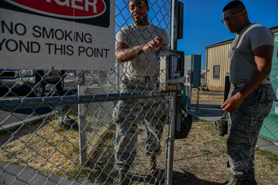 Airman 1st Class Tyrese Kirk and A1C Roderius Spearman, 9th Logistics Readiness Squadron Petroleum, Oil and Lubricants fuels distribution system operators, walk to their fuel trucks during a refueling exercise September 6, 2019 at Beale Air Force Base, California. (U.S. Air Force photo by Tech. Sgt. Alexandre Montes)