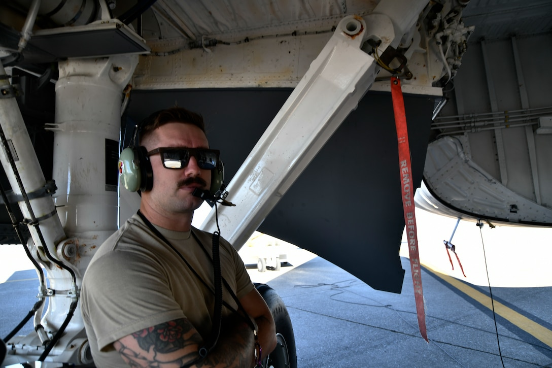 Staff Sgt. Brandon Buhler, 940th Aircraft Maintenance Squadron crew chief, watches the fuel gauge of a KC-135 Stratotanker during a refueling exercise September 6, 2019 at Beale Air Force Base, California. (U.S. Air Force photo by Tech. Sgt. Alexandre Montes)