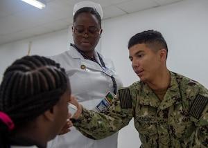 Medics treat a patient.