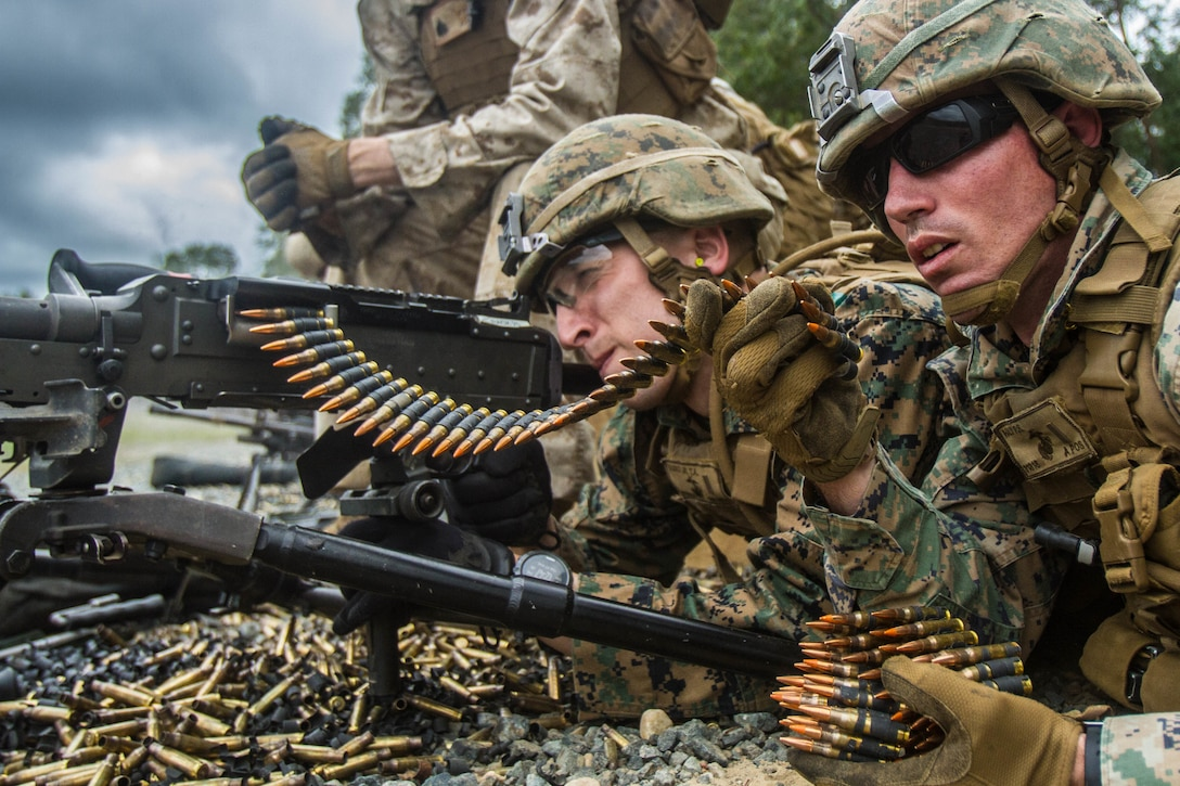 Second Lieutenants Tom Vasko and Phillip Haly, students at the Basic Officer Course, fire their M240 medium machine gun during the Crew Served Weapons Live Fire Exercise, at Marine Corps Base Quantico, Virginia, August 27, 2019. The Basic Officer Course is eight months long and is designed to train and educate newly commissioned or appointed officers in the high standards of professional knowledge, esprit-de-corps, and leadership to prepare them for duty as company grade officers in the Marine Corps, with particular emphasis on the duties, responsibilities, and warfighting skills required of a rifle platoon commander.