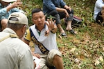 U.S. Army Sgt. 1st Class Kelvin Ngo, a linguist with the Defense POW/MIA Accounting Agency (DPAA) translates a witness account to Ray Kern, a DPAA analyst, during an investigation in Quang Nam province, Socialist Republic of Vietnam, June 17, 2019. DPAA was in the region conducting investigations in search of servicemembers who went missing during the Vietnam War. DPAA's mission is to provide the fullest possible accounting for our missing personnel to their families and the nation. (U.S. Navy photo by Mass Communication Specialist 1st Class Amara Timberlake)