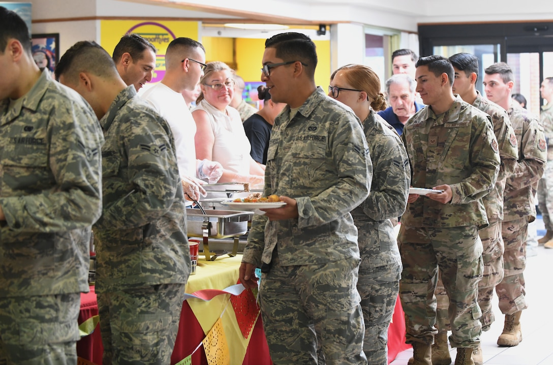 Airmen line up at the 'Taste of Latin America' food tasting event, held at the Base Exchange food court, on Ellsworth Air Force Base, S.D., Sept. 16, 2019. The food tasting included authentic dishes from Colombia, Mexico, Cuba and Puerto Rico. The event was hosted and catered by members of the Ellsworth Latin American Community (ELAC). (U.S. Air Force photo by Airman 1st Class Christina Bennett)