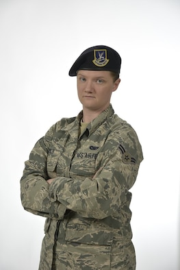 Airman First Class Kaitlyn Coble, 21st Security Forces Squadron entry controller, poses for a photo for the Year of the Defender campaign at Peterson Air Force Base, Colorado. Coble works as an entry controller for Cheyenne Mountain Air Force Station in Colorado. (U.S. Air Force illustration by Airman Alexis Christian)
