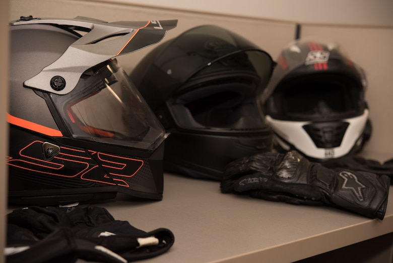 Motorcycle helmets and gloves are presented as examples of mandatory safety gear during a motorcycle safety class on August 28, 2019, at Whiteman Air Force Base, Missouri. The 509th Munitions Squadron motorcycle safety representatives recommend full-face helmets providing the most protection because face and jaw injuries occur the most during accidents. (U.S. Air Force photo by Airman 1st Class Parker J. McCauley)