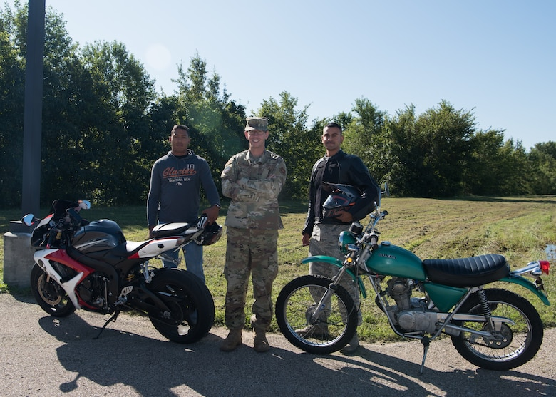 Staff Sergeants Trevor Griffin, Paul Kurtenbach, and Senior Airman Carlos Rivera, the 509th Munitions Squadron motorcycle safety representatives, stand for a group photo with their motorcycles on August 28, 2019, at Whiteman Air Force Base, Missouri. Safety representatives oversee the motorcycle safety programs within their units, identifying mentors, and promoting good and safe habits. (U.S. Air Force photo by Airman 1st Class Parker J. McCauley)