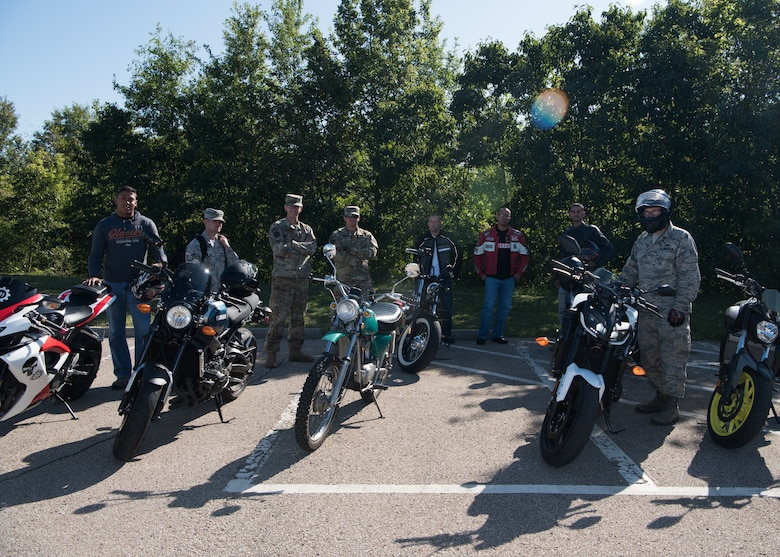 Airmen with the 509th Munitions Squadron and the 131st Maintenance Squadron Munitions Flight stand with their bikes for a group photo after attending a motorcycle safety class before they went on a group ride on Aug. 28, 2019, at Whiteman Air Force Base, Missouri. (U.S. Air Force photo by Airman 1st Class Parker J. McCauley)