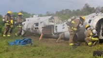 Aircraft Recovery and Fire Fighting (ARFF) Marines inspect a crashed plane for potential hazards during an aircraft recovery scenario at Marine Corps Auxiliary Landing Field Bogue, North Carolina, Aug. 16, 2019. ARFF Marines attached to Marine Wing Support Detachment 273 trained to improve readiness, efficiency, and recovery times.