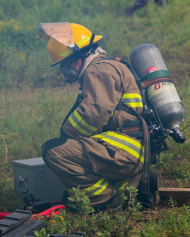 U.S. Marine Corps Cpl. Terrence D. Moran, an aircraft rescue and firefighting specialist, transports a fire hose during an aircraft recovery scenario at Marine Corps Auxiliary Landing Field Bogue, North Carolina, Aug. 15, 2019. ARFF Marines attached to Marine Wing Support Detachment 273 trained to improve readiness, efficiency, and recovery times.