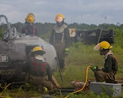Aircraft Recovery and Fire Fighting (ARFF) Marines measure areas of a crashed plane during an aircraft recovery scenario at Marine Corps Auxiliary Landing Field Bogue, North Carolina, Aug. 16, 2019. ARFF Marines attached to Marine Wing Support Detachment 273 trained to improve readiness, efficiency, and recovery times.