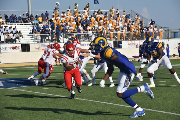 Angelo State University Rams and Simon Fraser University players compete during the ASU military appreciation night at 1st Community Credit Union Field, San Angelo, Texas, Sept. 14, 2019. ASU hosted SFU, a Canadian football team and won the game 68-7. (U.S. Air Force photo by Senior Airman Seraiah Wolf/Released)