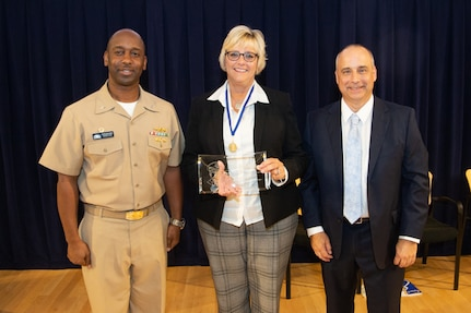 Chief of Staff Kathy Stanley receives the Vice Adm. Samuel Gravely Award during the Naval Surface Warfare Center, Carderock Division Honor Awards on Sept. 10, 2019, in West Bethesda, Md. With Stanley is Commanding Officer Capt. Cedric McNeal and Technical Director Larry Tarasek. (U.S. Navy photo by Nicholas Brezzell/Released)
