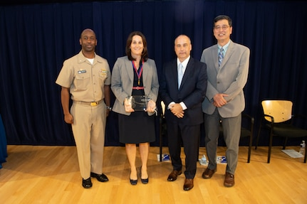 Dr. Anne Fullerton, head of the Emergent Technology Branch, receives the Rear Adm. David Taylor Award the Naval Surface Warfare Center, Carderock Division Honor Awards on Sept. 10, 2019, in West Bethesda, Md. With Fullerton is Commanding Officer Capt. Cedric McNeal, Technical Director Larry Tarasek and Ship Signatures Department Head Dr. Paul Shang. (U.S. Navy photo by Nicholas Brezzell/Released)